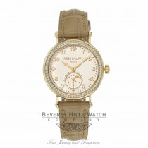 Patek Philippe Lady's 33mm 18k Yellow Gold Cream Colored Dial 7121J-001 CKRAU8 - Beverly Hills Watch